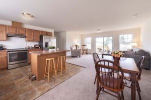 View of open concept living and dining room in independent living cottage